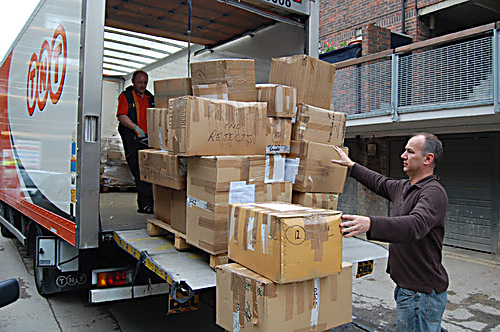 Picture caption: Rob Miller, Music Fund Director loads the boxes of ballet shoes and instruments ready to send to the airport.