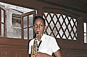Student at the national Music School playing a saxophone which needs 19 new reeds a year