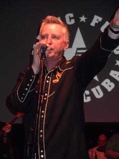 Billy Bragg performing at the tribute to Kirsty